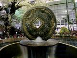 水泥铜钱雕塑